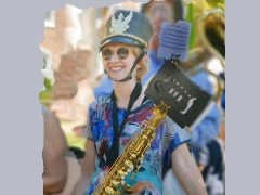 Saxophonist Preparing To March In A Parade by Wtangel